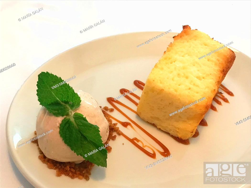 Stock Photo: Sponge cake with ice cream and mint leaves.