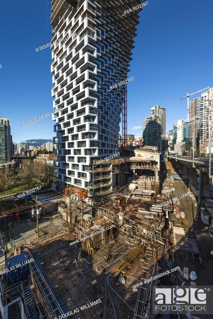 Stock Photo: Vancouver House, a tower under construction in Vancouver, BC, Canada.