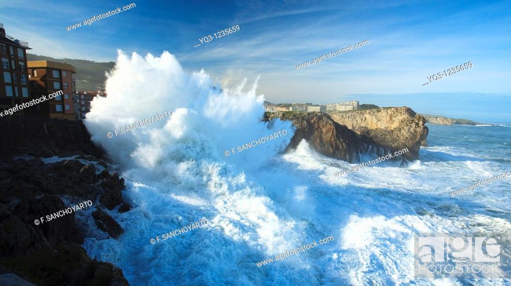 Stock Photo: Northwestern waves breaking against buildings during storm. Castro Urdiales, Cantabria, Northern Spain.