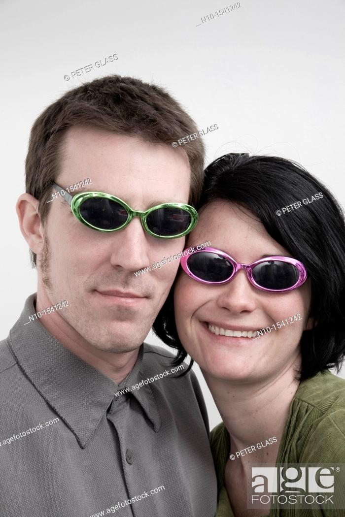 Stock Photo: Husband and wife wearing sunglasses.