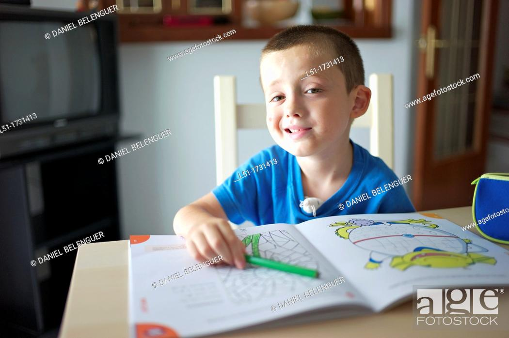 Stock Photo: boy making fun while doing homework, Ludiente, Castellón, Spain.