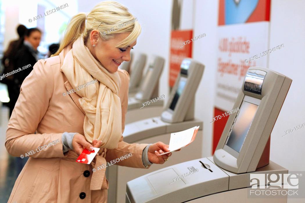 Stock Photo: woman checks her bank account.