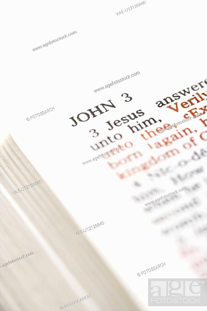 Stock Photo: Selective focus of John 3 verses in open Holy Bible.