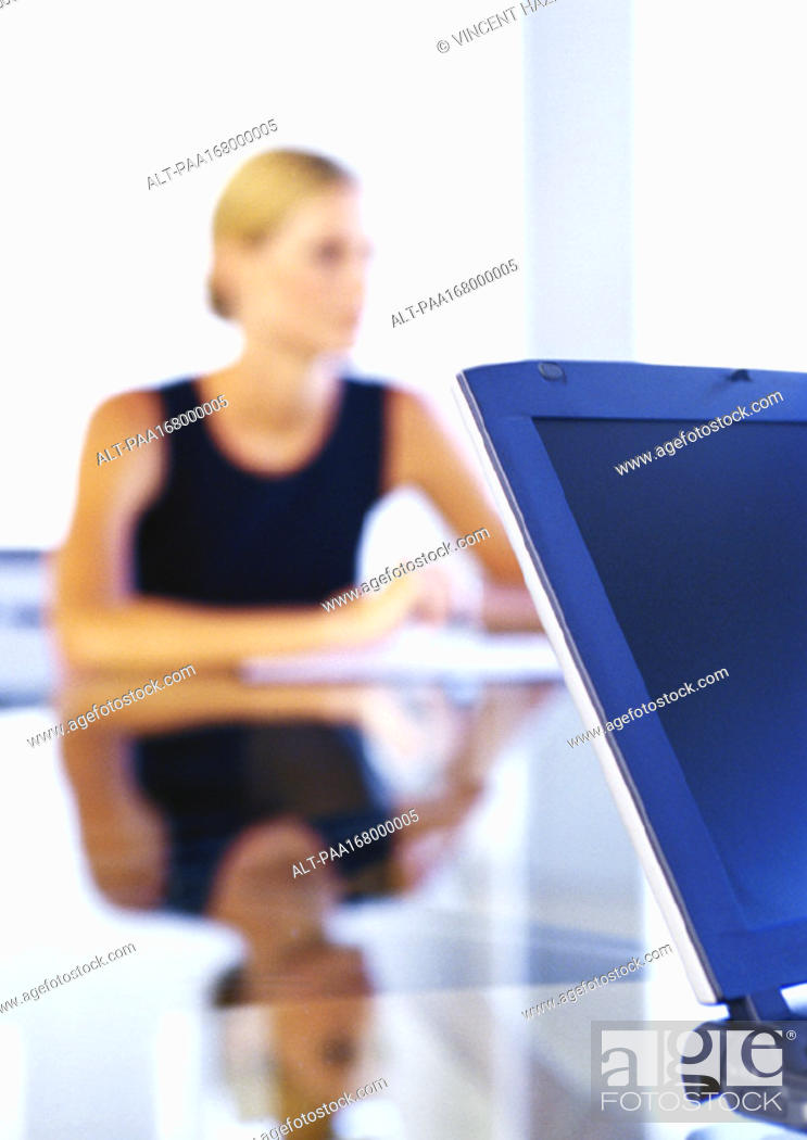 Stock Photo: Businesswoman sitting at desk.