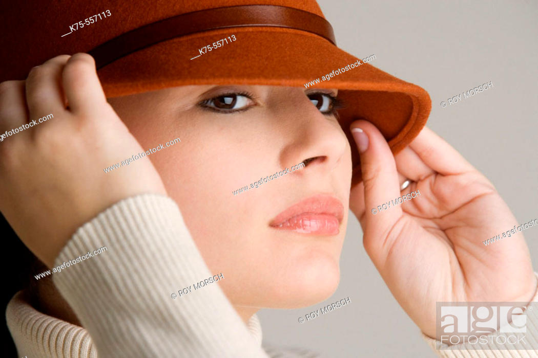 Stock Photo: Portrait of caucasian-hispanic woman in her twenties with a hat.