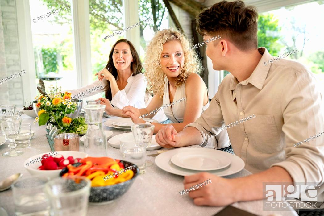 Stock Photo: Young man and woman flirting on a family celebration.