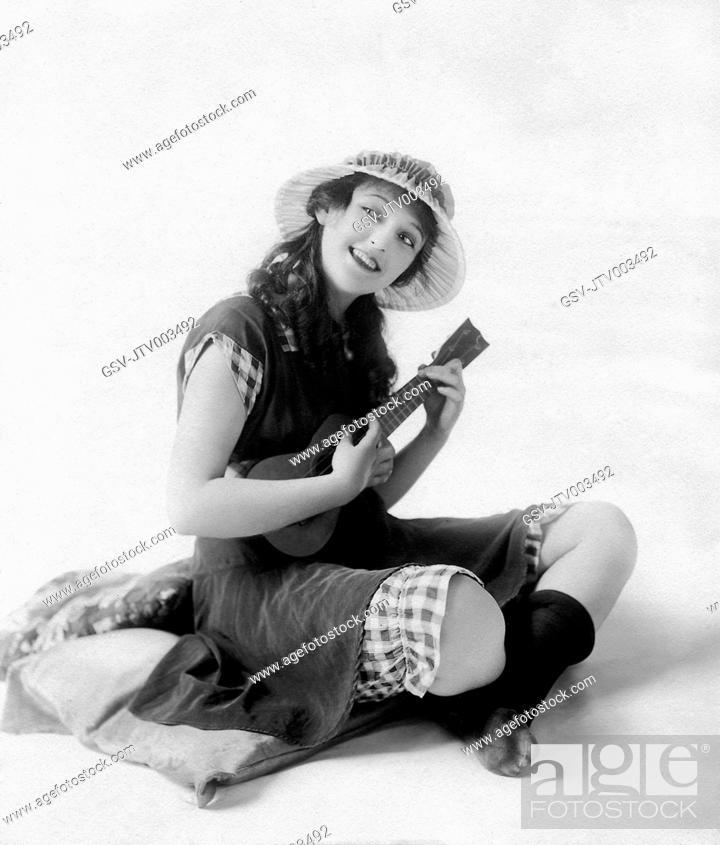 Stock Photo: Carmel Myers Playing Ukulele, circa 1920s.