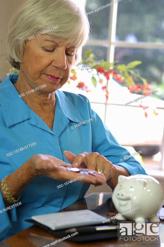 Stock Photo: Close-up of a senior woman counting coins.