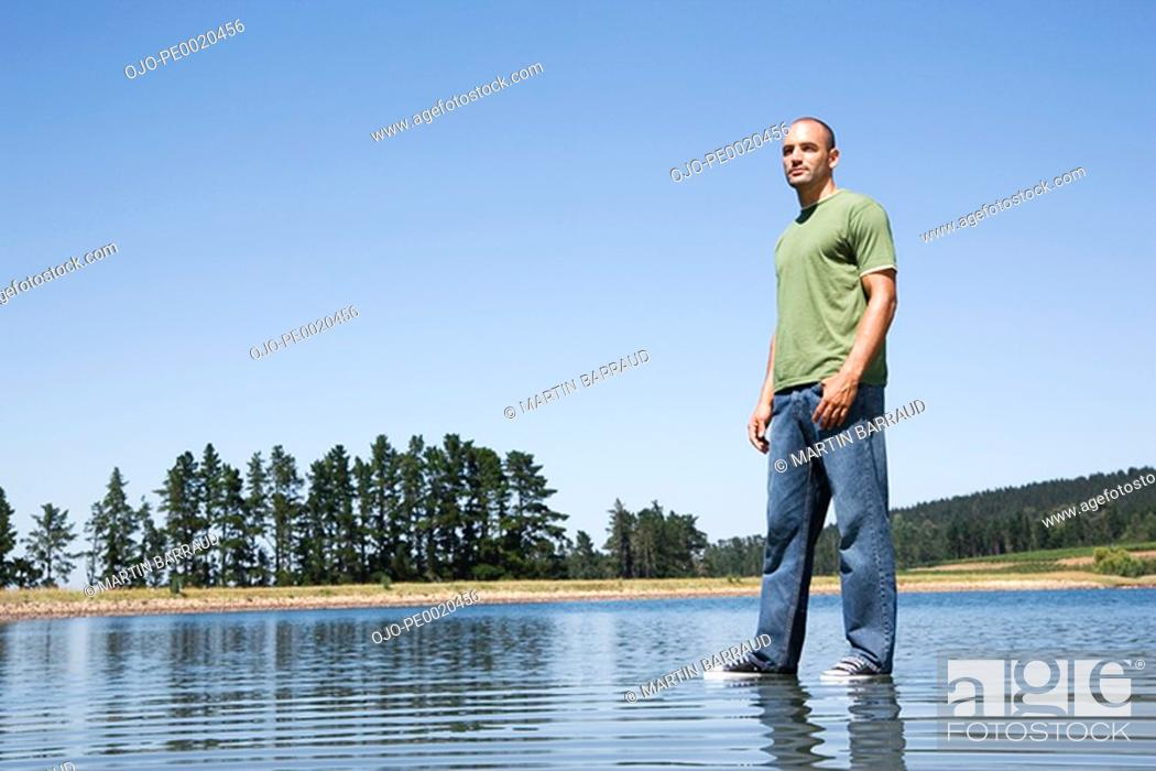 Stock Photo: Man standing on water.