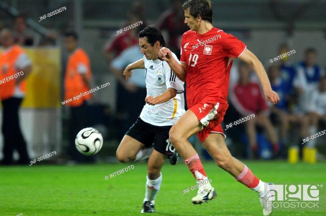 Stock Photo: Sport, football, world championships, Germany versus Poland, 1:0, Dortmund, 14 6 2006, from left to right, Oliver Neuville, Bartosz Bosacki, footballer, sports.