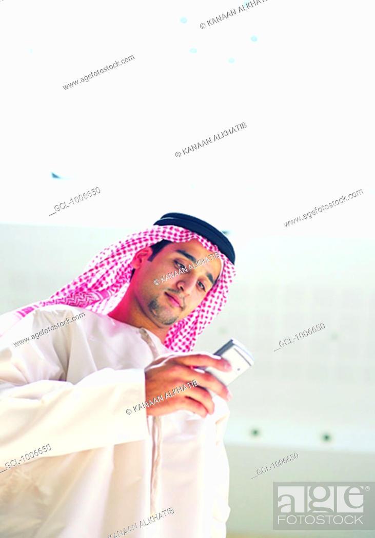 Stock Photo: Arab man using mobile phone.