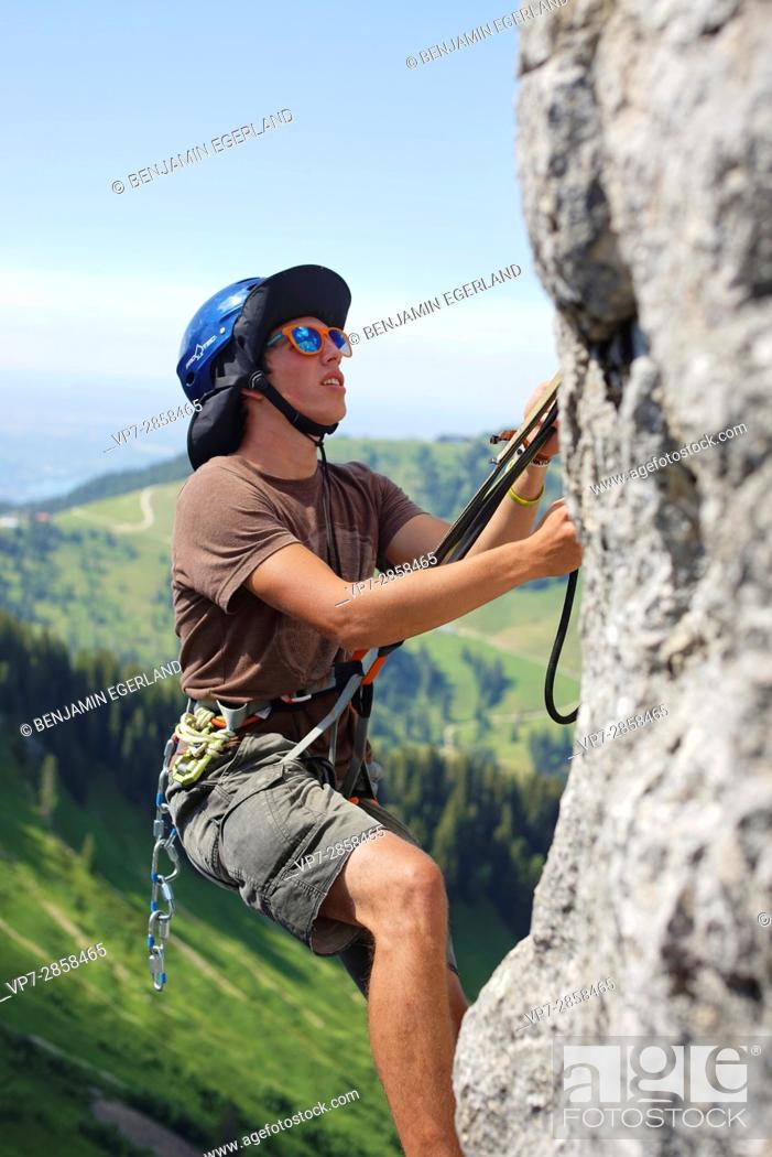 Photo de stock: young climber in Bavarian alps, near mountain Blankenstein, south of Germany.