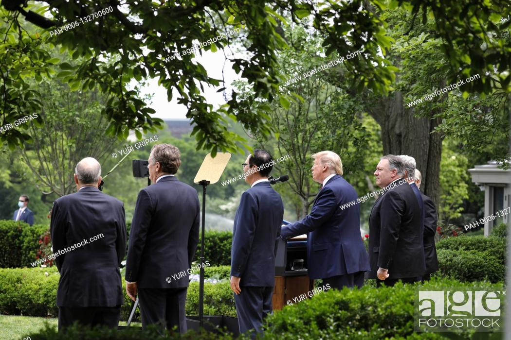 Stock Photo: United States President Donald J. Trump with members of his administration delivers remarks on China in the Rose Garden at the White House in Washington.