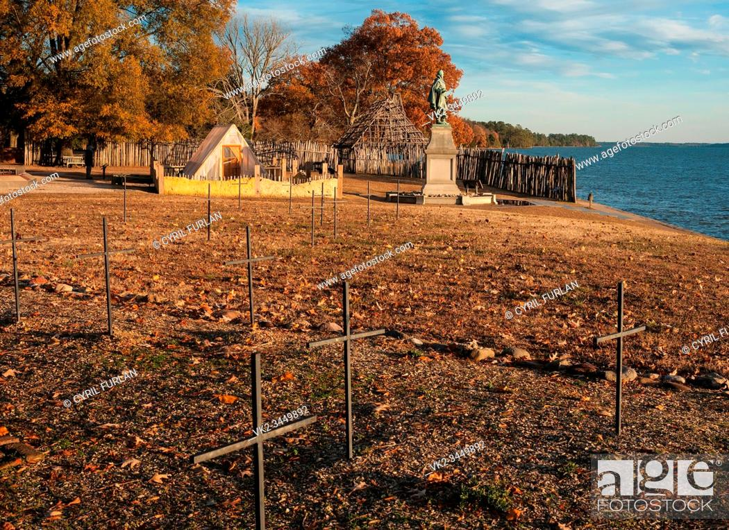 Stock Photo: Jamestown is the site where English Colonist landed in Virginia, foreground crosses are graves discovered by ground radar, statue is of Captain John Smith.
