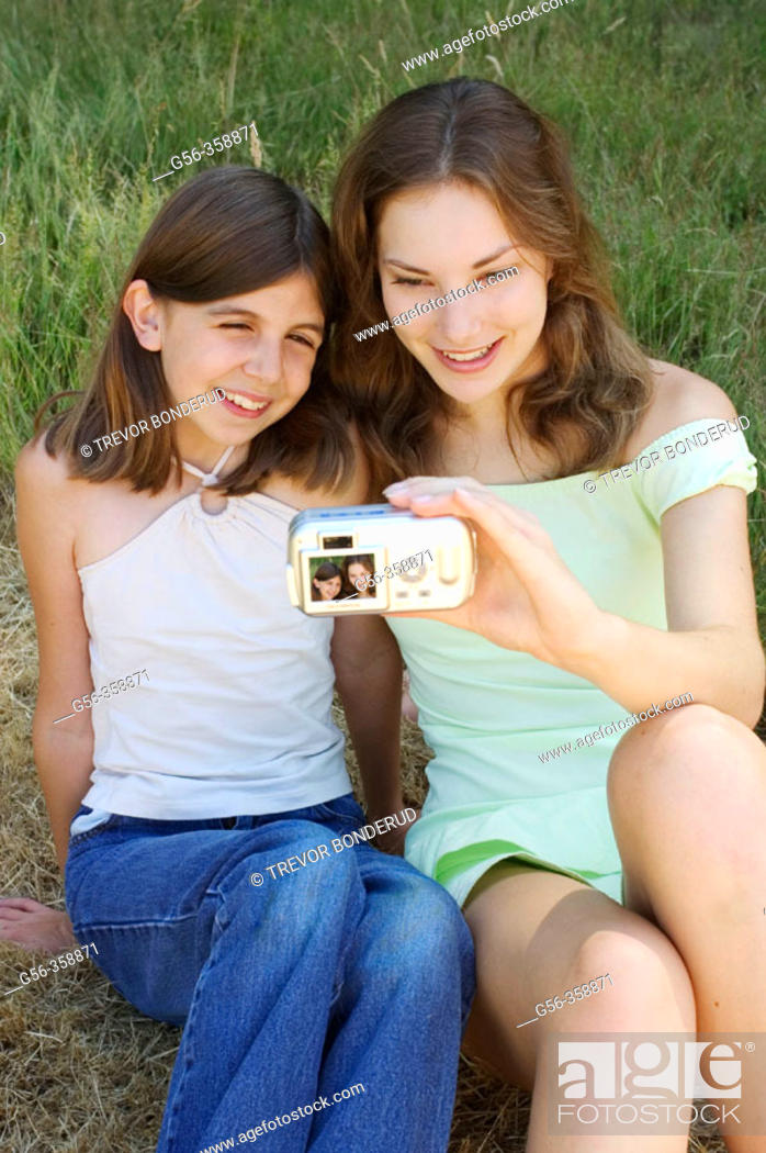 Stock Photo: Friends with camera.