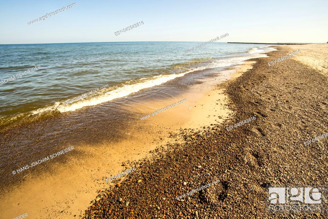 Stock Photo: lonesome beach of the Baltic Sea with blue sky in Poland.