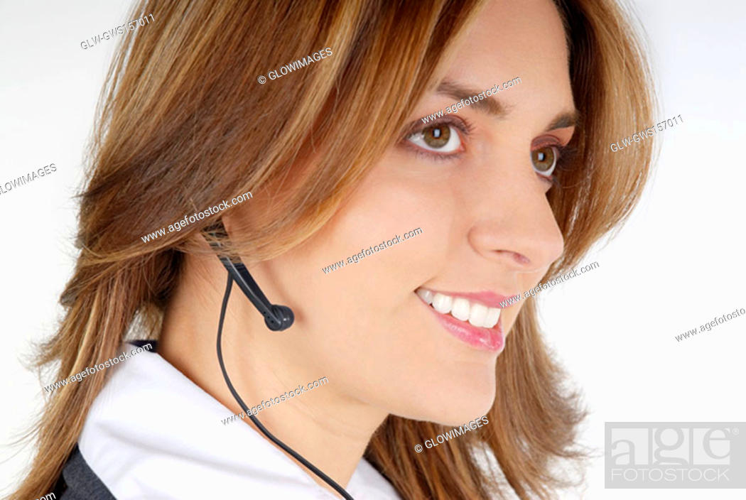 Stock Photo: Side profile of a businesswoman with a hands free device.