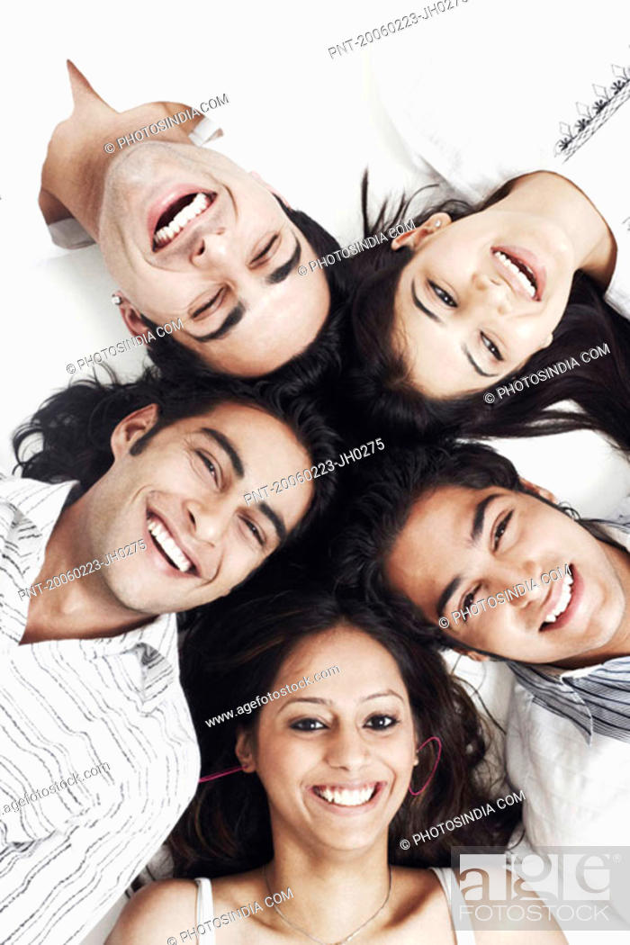Stock Photo: Portrait of three young men and two young women lying down.