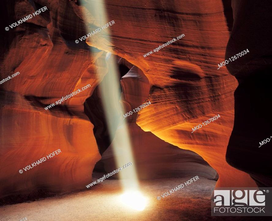 Stock Photo: Ray of sunlight in cave.