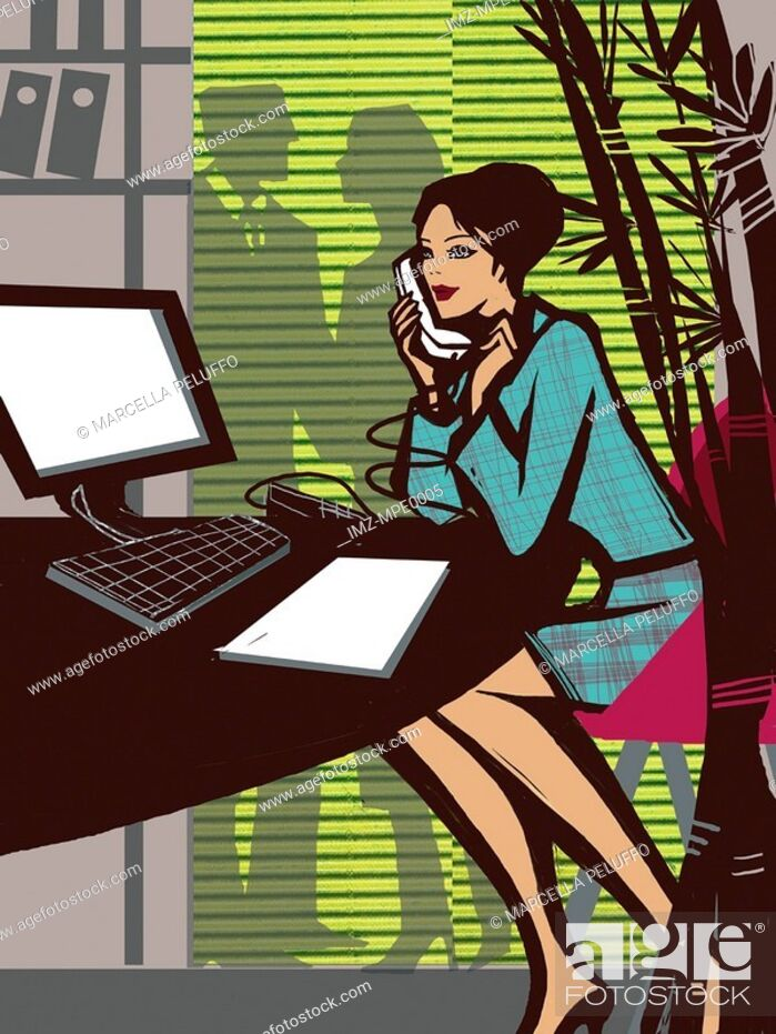 Stock Photo: A woman talking on the phone while working in the office.