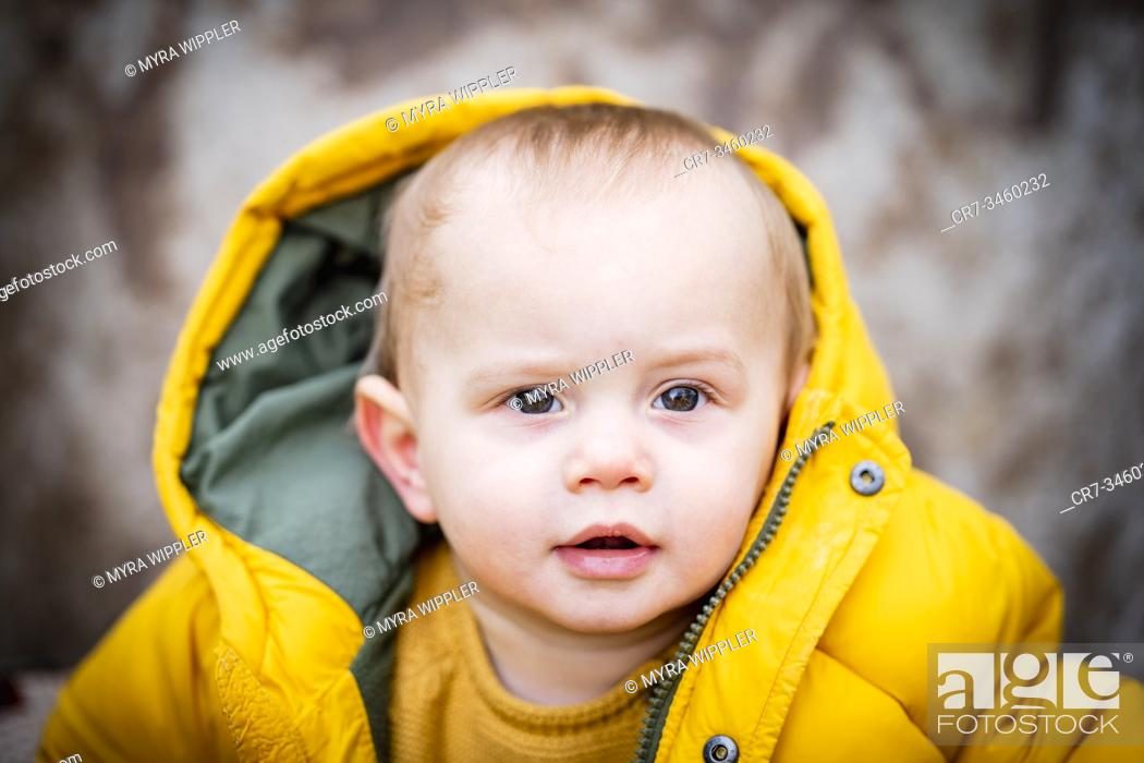 Stock Photo: Baby boy portrait in autumn leaves and wheelbarrow.