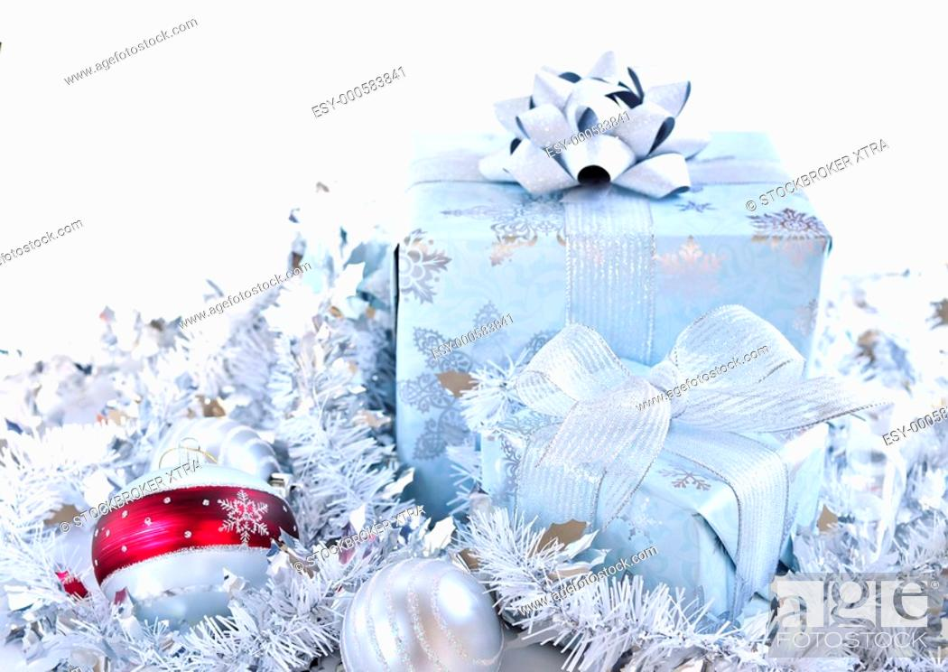 Stock Photo: Two gift boxes with Christmas ornaments on white background.