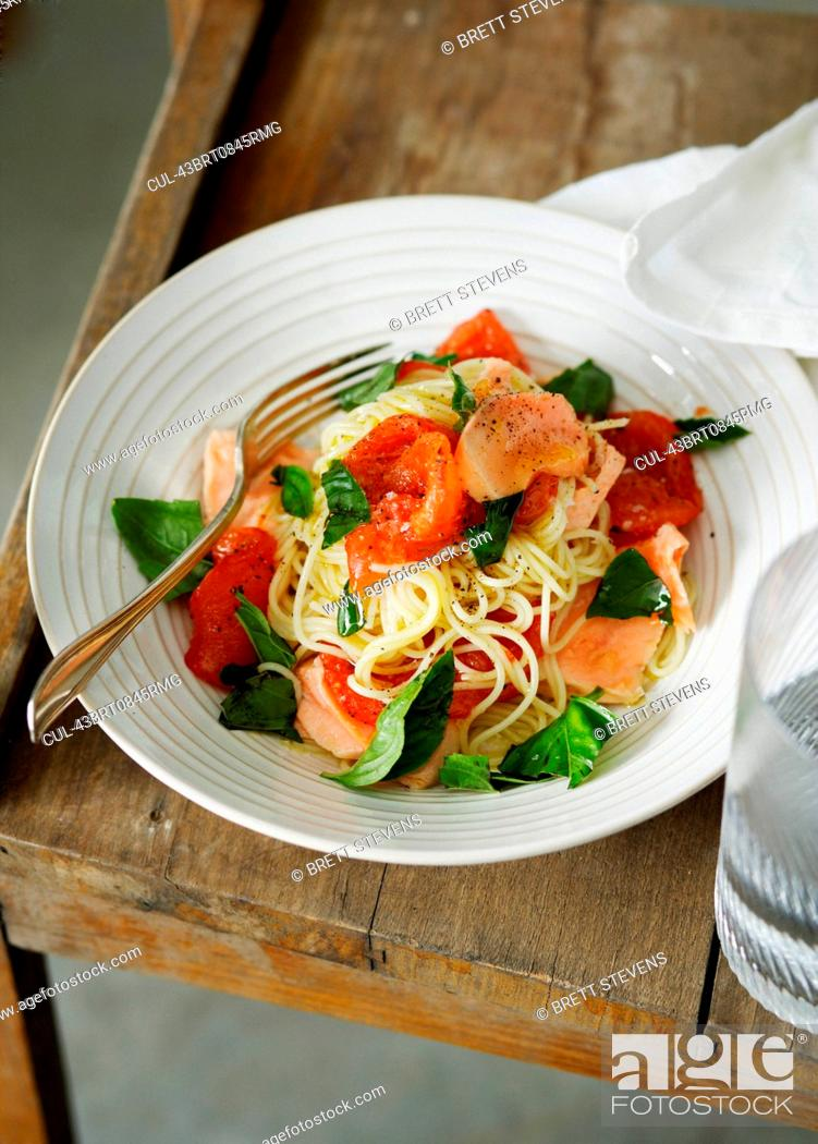 Stock Photo: Plate of fish and tomato pasta.