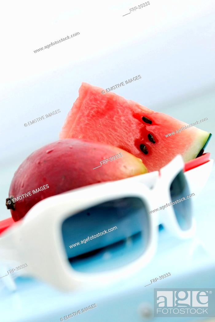 Stock Photo: Plate with watermelon, mango and sunglasses.