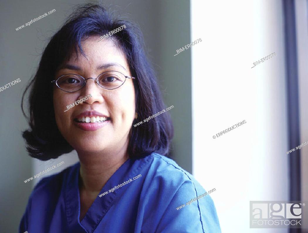 Stock Photo: Portrait of female doctor smiling.