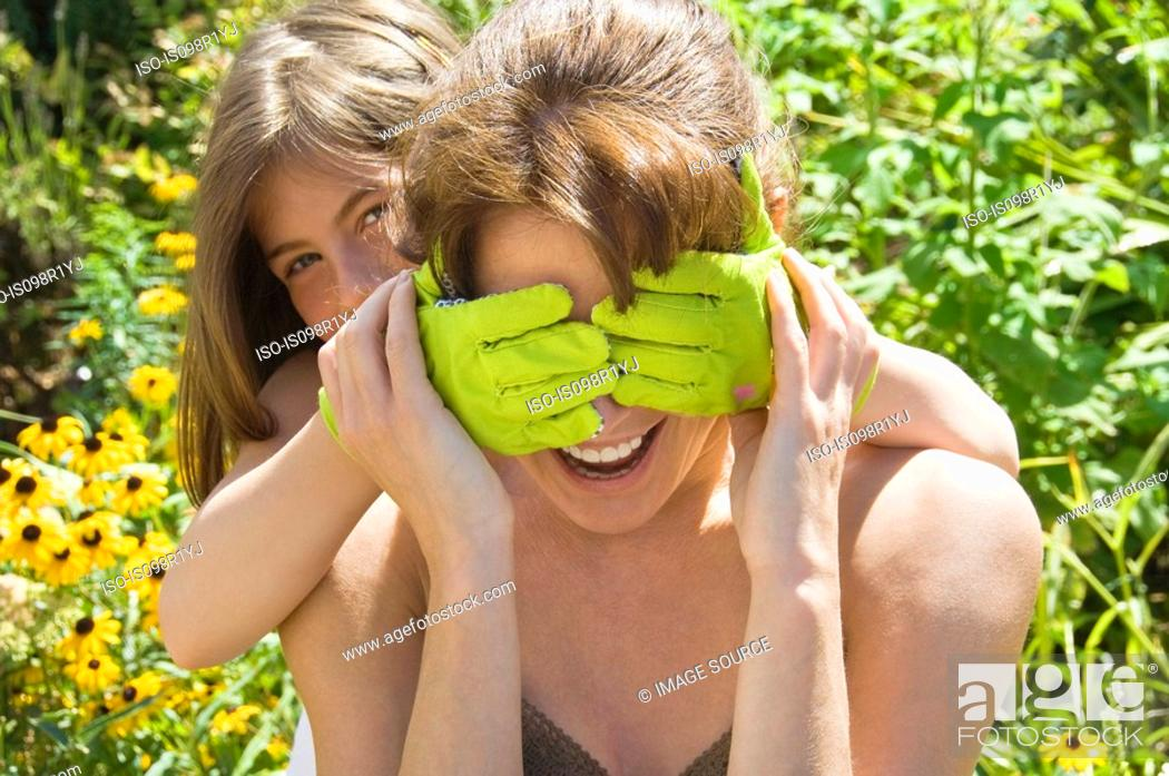 Stock Photo: Mother and daughter playing.
