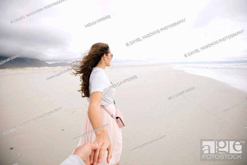 Stock Photo: South Africa, Western Cape, Hermanus, woman holding hand on the beach.