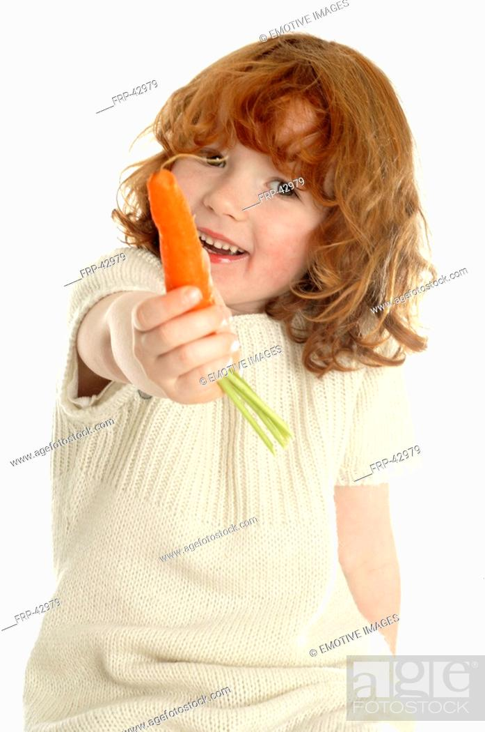 Stock Photo: Little girl with a carrot.