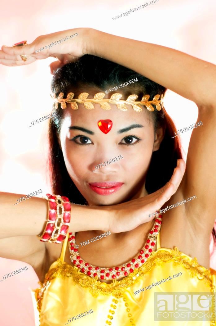 Stock Photo: Young Asian woman as exotic dancer in studio setting.