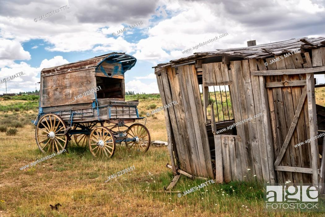 Stock Photo: An old west sheriff's wagon sits on the lonesome frontier prarie as storm clouds gather in the distance.