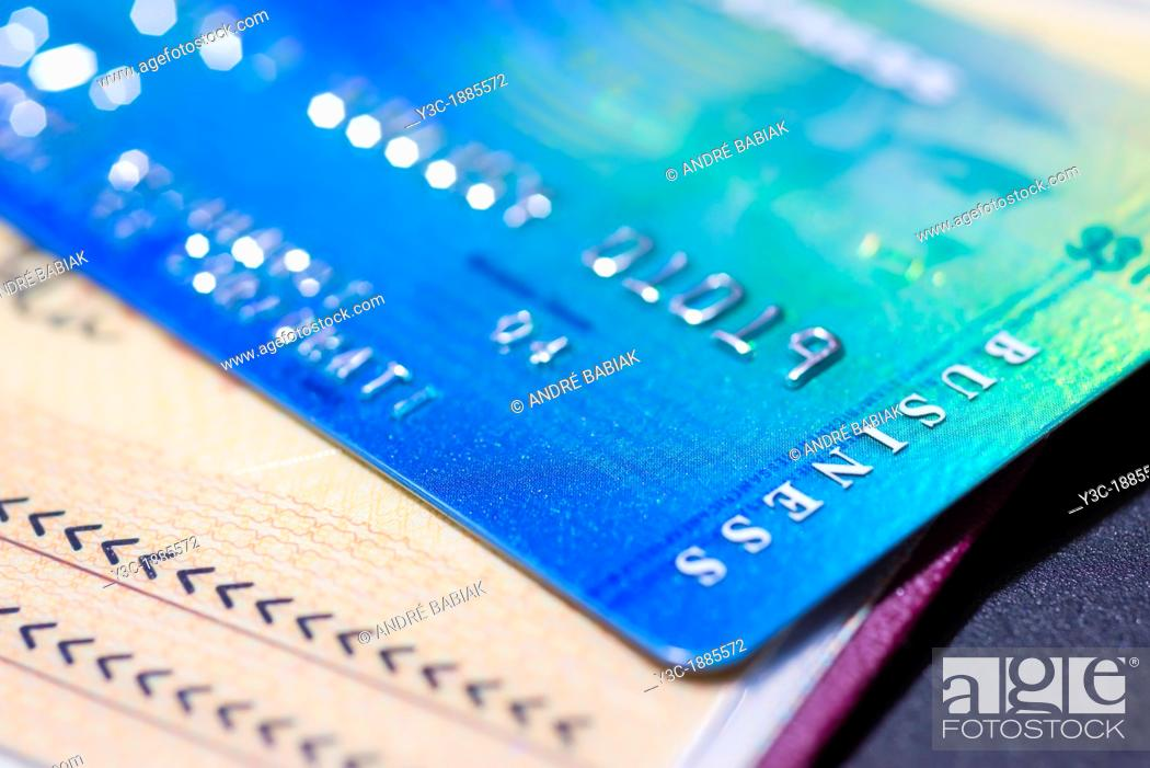 Stock Photo: Close up of American Express Business Credit Card on Passport.