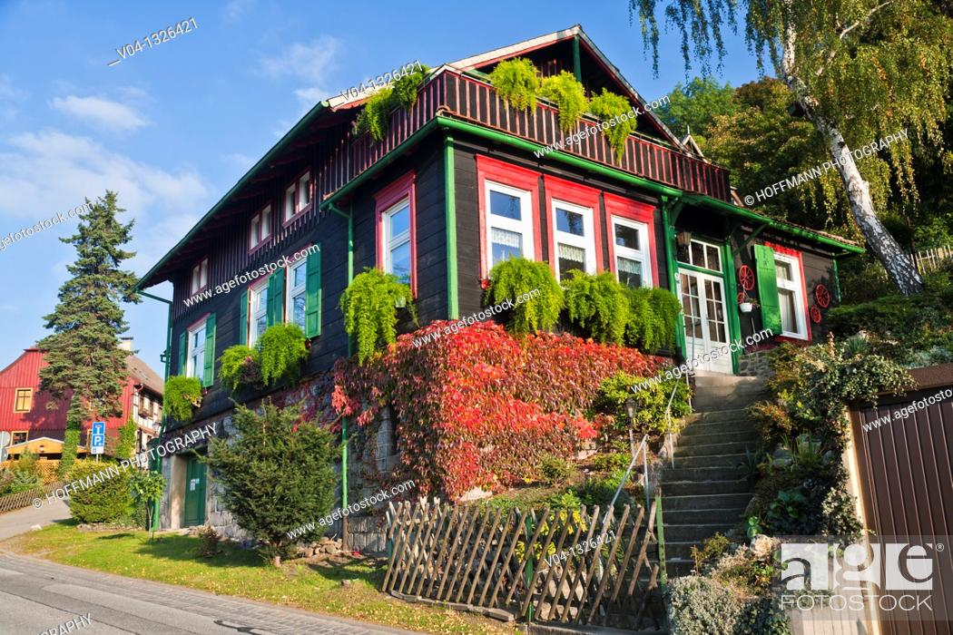 Stock Photo: Wooden building with colorful plant cover in Wernigerode, Saxony Anhalt, Germany, Europe.
