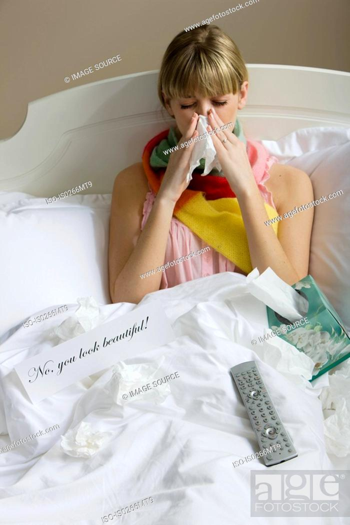 Stock Photo: A woman in bed with a cold.