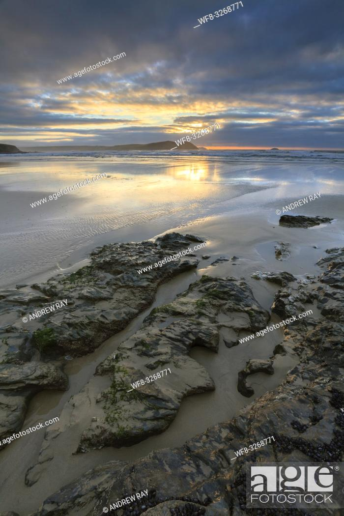 Stock Photo: Polzeath Beach at the mouth of Cornwall's Camel Estuary, captured shortly before sunset in mid February.