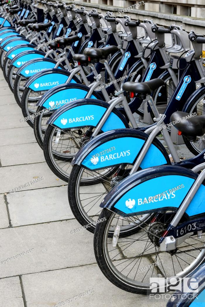 Stock Photo: Row of parked Transport for London Barclays bicycles for hire, London. The hire scheme was introduced in 2010 by London mayor Boris Johnson.