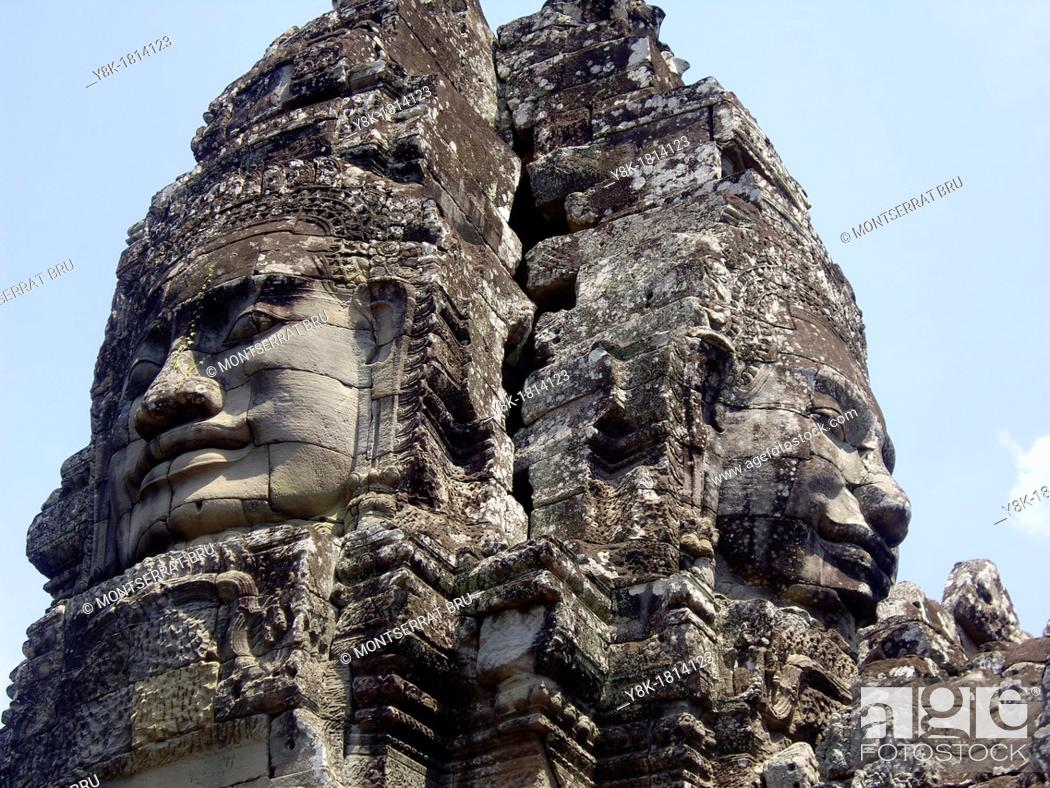 Stock Photo: Stone face tower at Bayon temple, Cambodia.