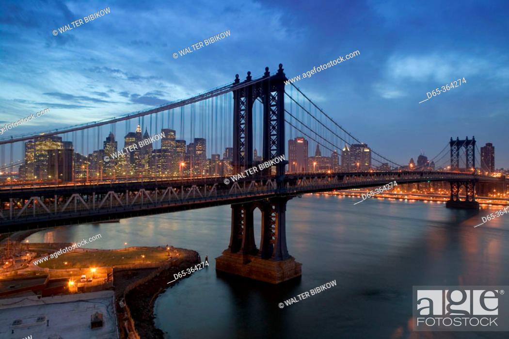 Stock Photo: Aerial view from Brooklyn at dusk. Manhattan and Brooklyn bridges and Lower Manhattan. New York city. USA.
