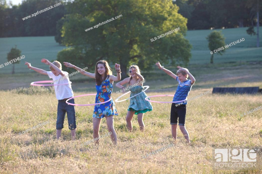 Stock Photo: Children playing with hula hoops.
