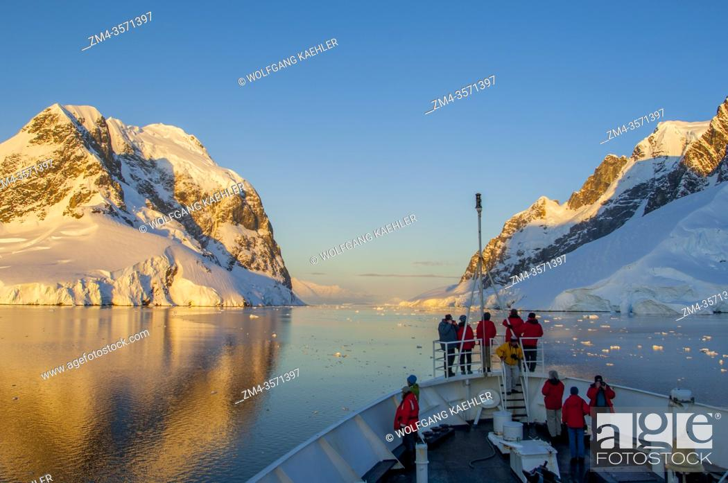 Stock Photo: The MV Sea Adventurer (formerly MV Clipper Adventurer) cruising in the Lemaire Channel, Antarctic Peninsula in the midnight sunshine.