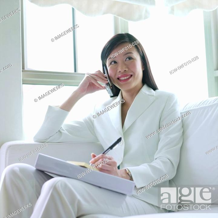 Stock Photo: Businesswoman talking on a mobile phone.