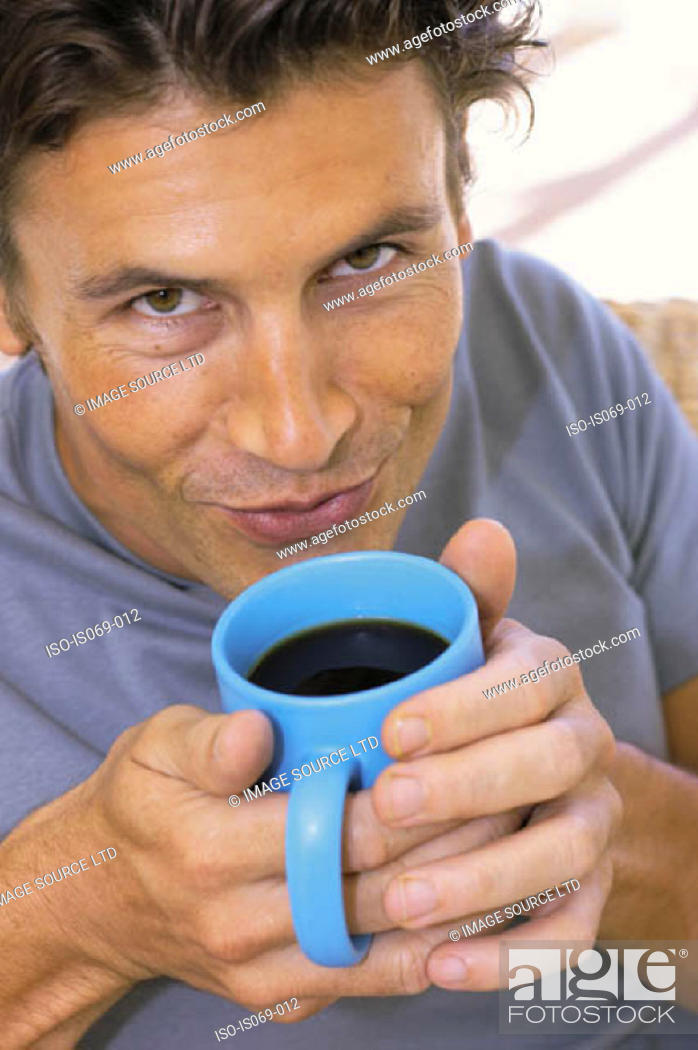 Stock Photo: Man drinking coffee.