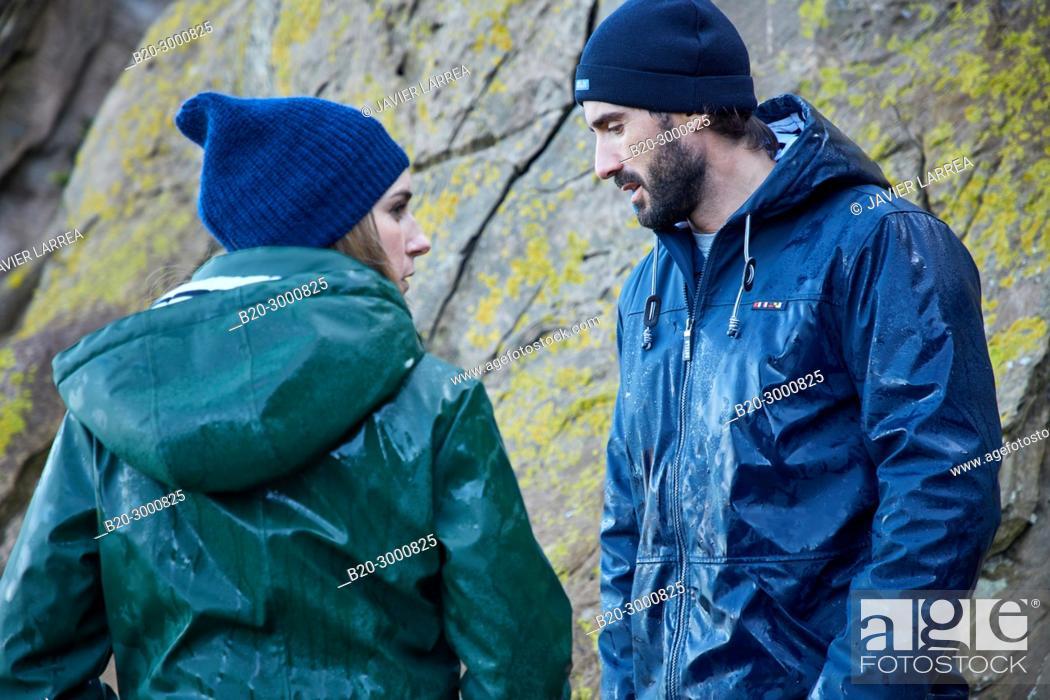 Stock Photo: Couple at the coast of Santa Clara Island, Donostia, San Sebastian, Gipuzkoa, Basque Country, Spain, Europe, Raincoat, Winter.