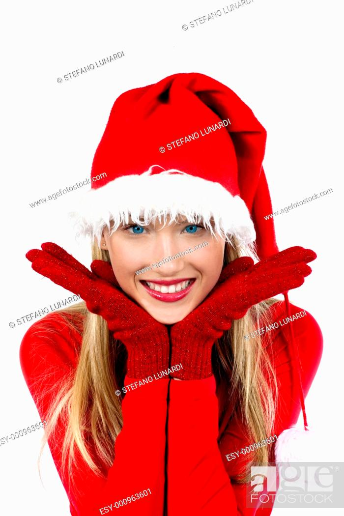Stock Photo: Portrait of beautiful girl wearing Santa Claus hat on white background.