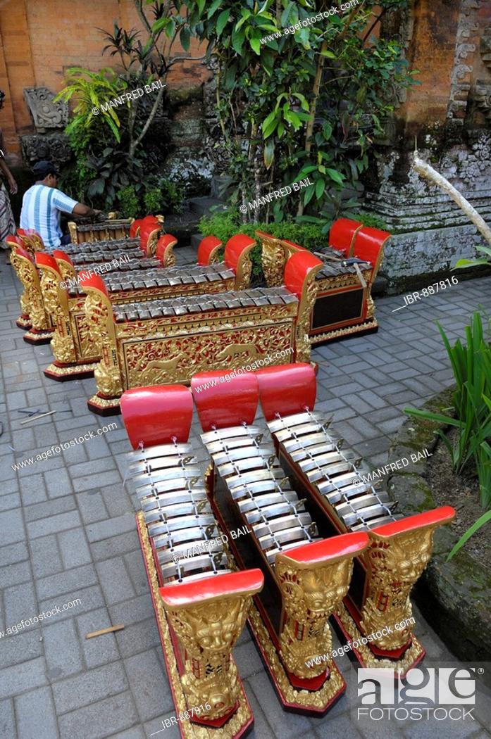 Stock Photo: Gamelan musical ensemble instruments being restored at Puri Saren Palace, Ubud, Bali, Indonesia.