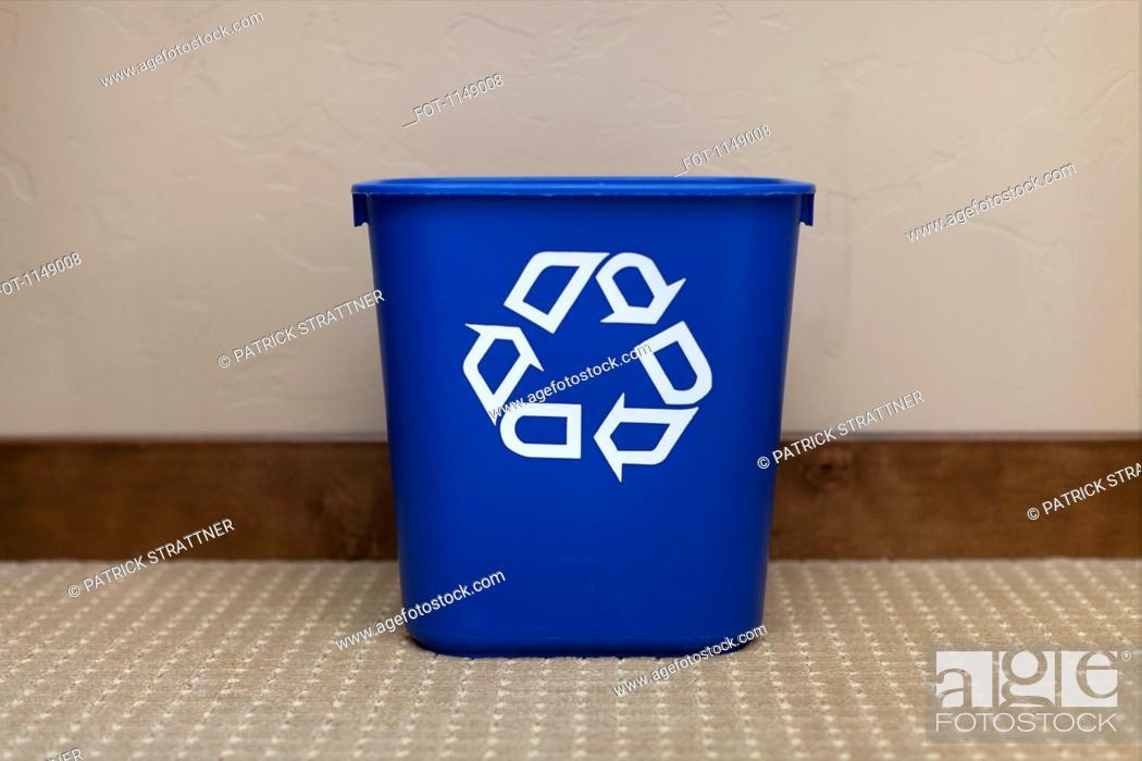 Stock Photo: A blue recycling bin.