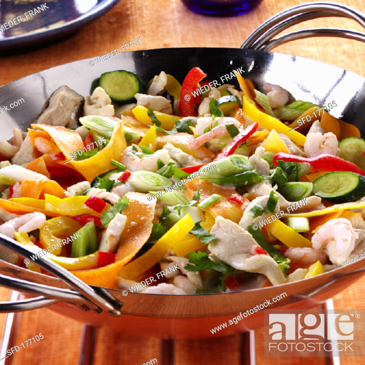 Stock Photo: Wok-cooked dish with vegetables, chicken & shrimps.
